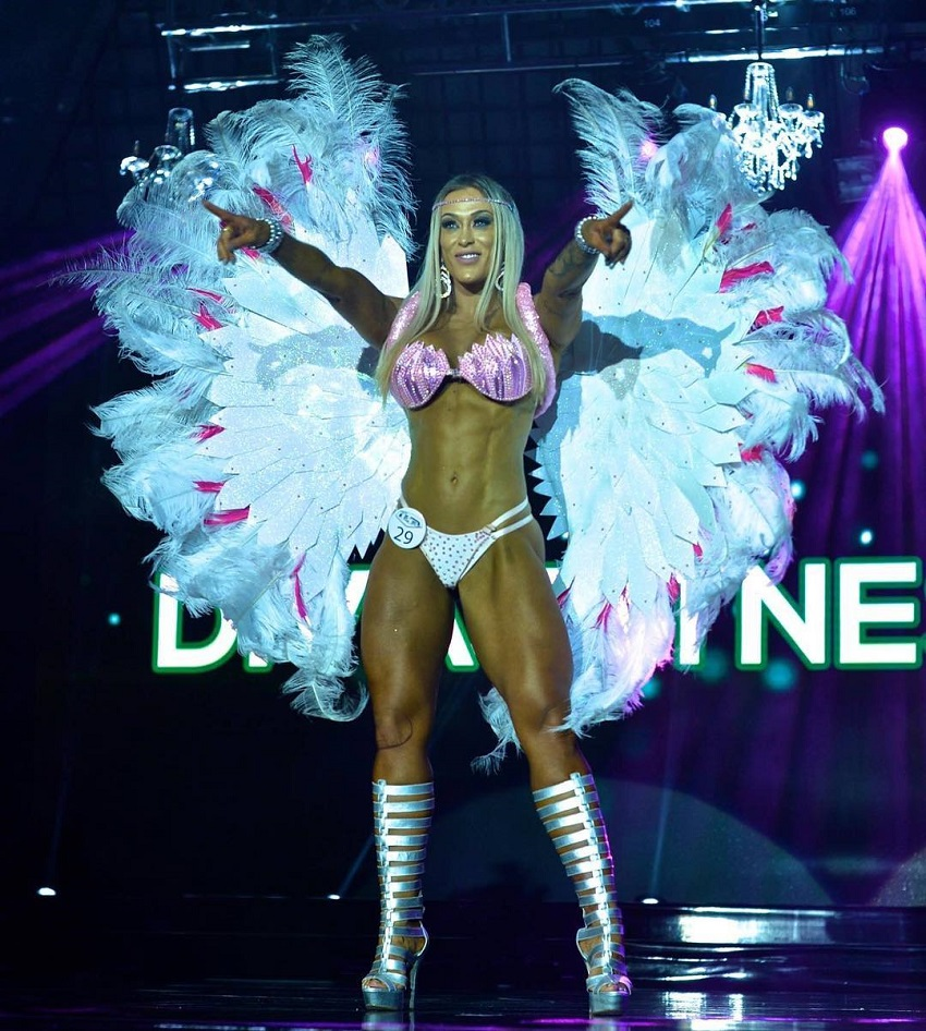Rochelle Michielin posing on the WBFF stage showing off her ripped and fit body to the audience