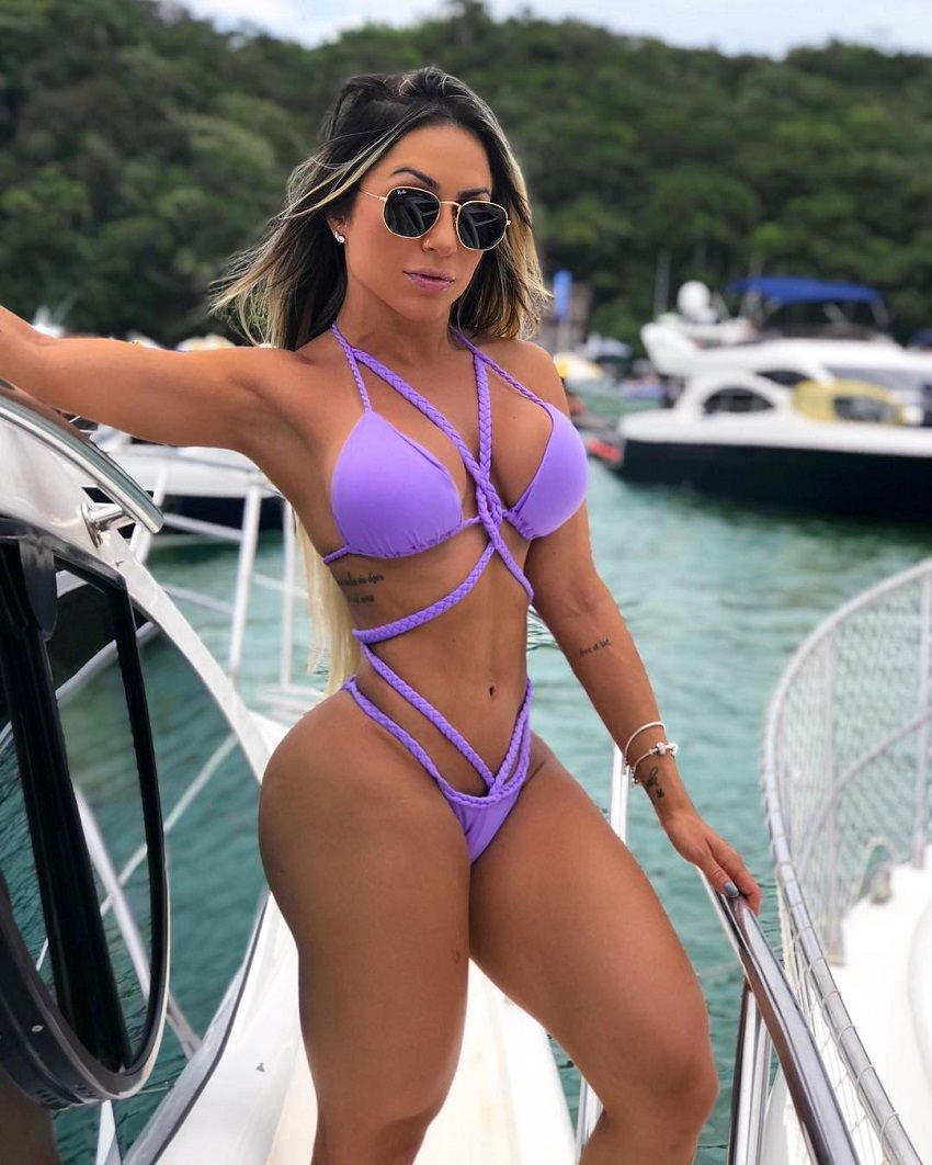 Tatiane Almeida posing on a boat looking fit