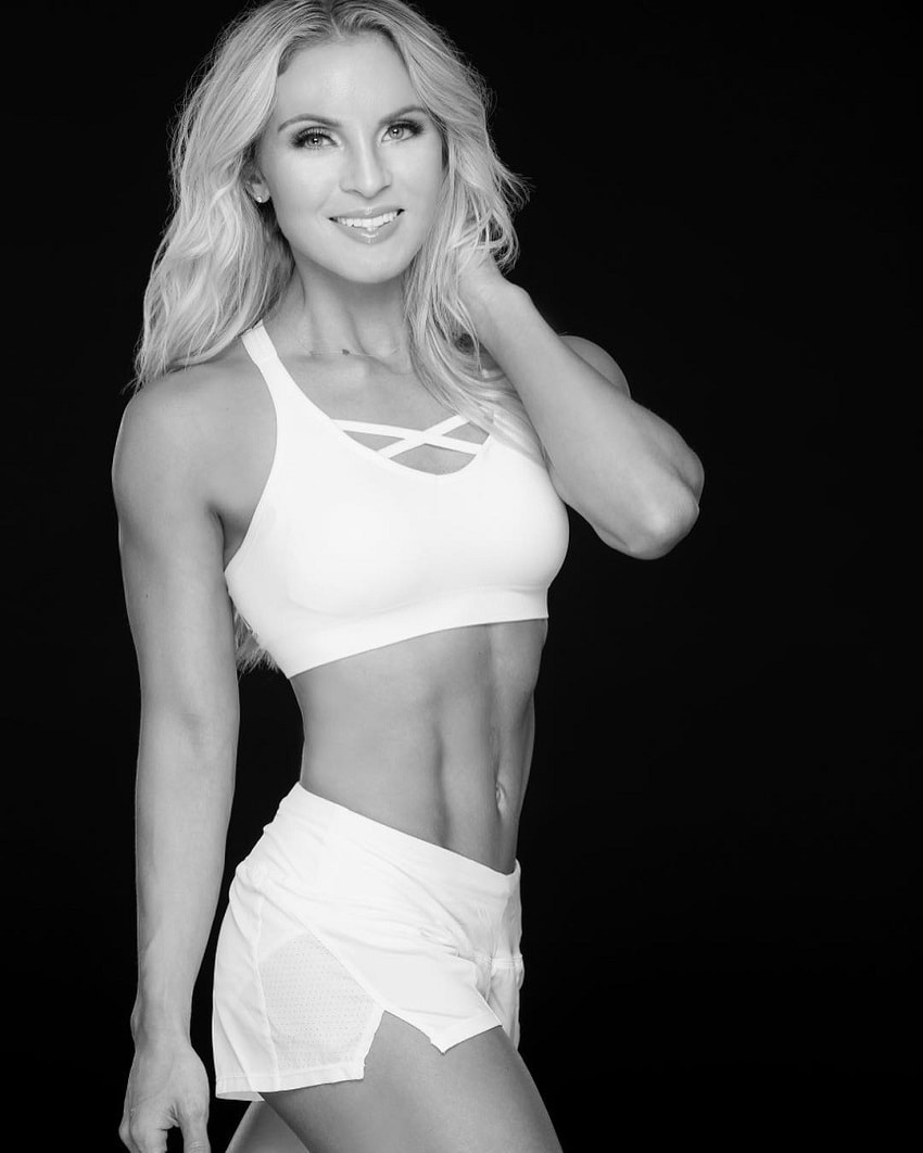 Ashley Nordman posing in a professional fitness photo shoot, looking lean and fit