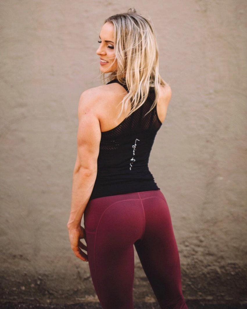 Ashley Nordman showing off her back in sports clothes looking fit and lean