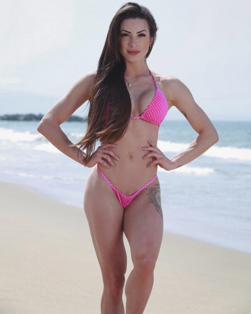 Bruna Montenegro posing on the beach for the photo looking fit and lean