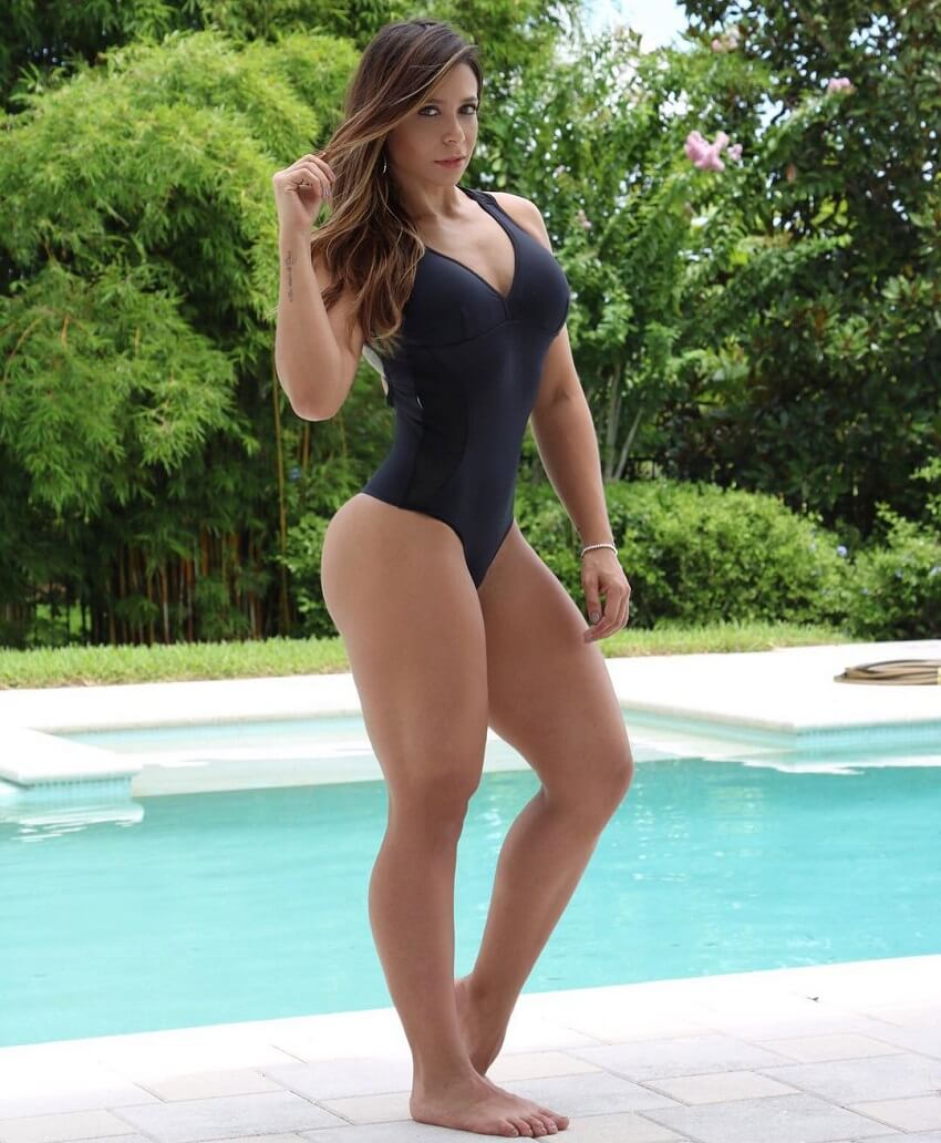 Carol Porcelli showing off her fit and lean body by the pool