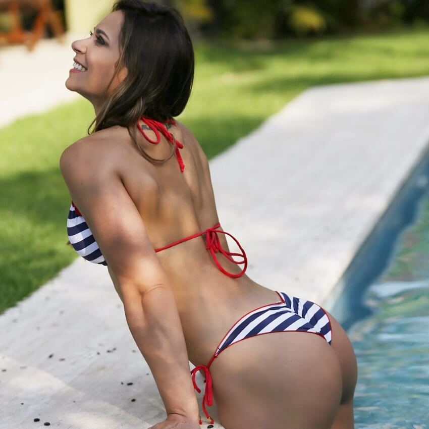 Carol Porcelli coming out of a pool looking fit and lean
