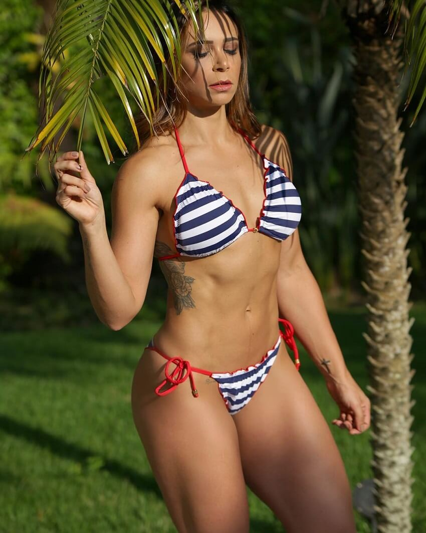 Carol Porcelli posing in nature looking fit