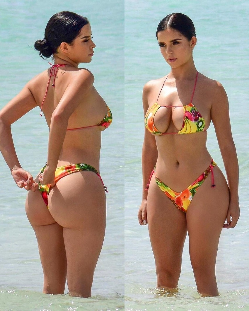 Demi Rose Mawby standing in the sea in her swimsuit looking fit and curvy