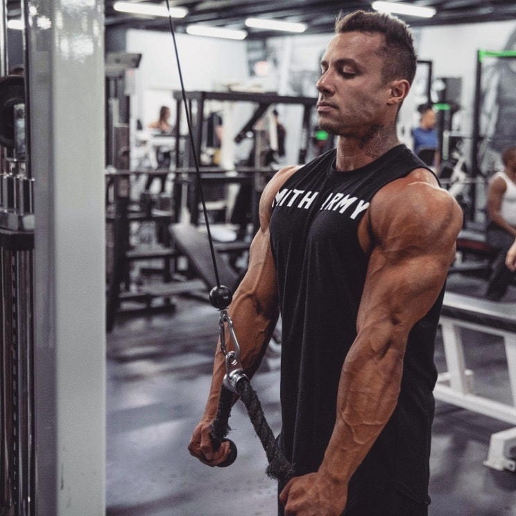 Diogo Montenegro training triceps with cable extensions in the gym