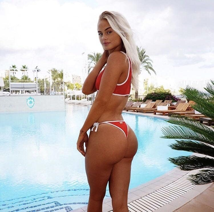 Filippa Fransson posing for the photo in her red swimming suit looking curvy and fit