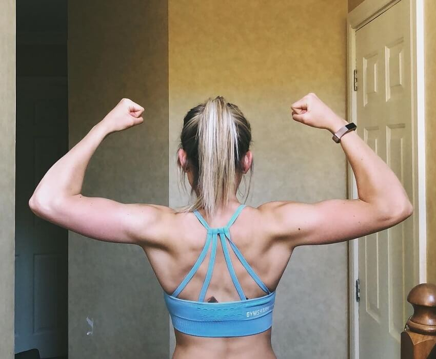 Fiona Simpson flexing her back muscles for the photo