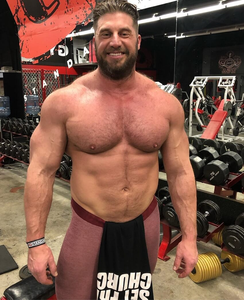 Gabe Moen posing shirtless for the photo, looking big and strong