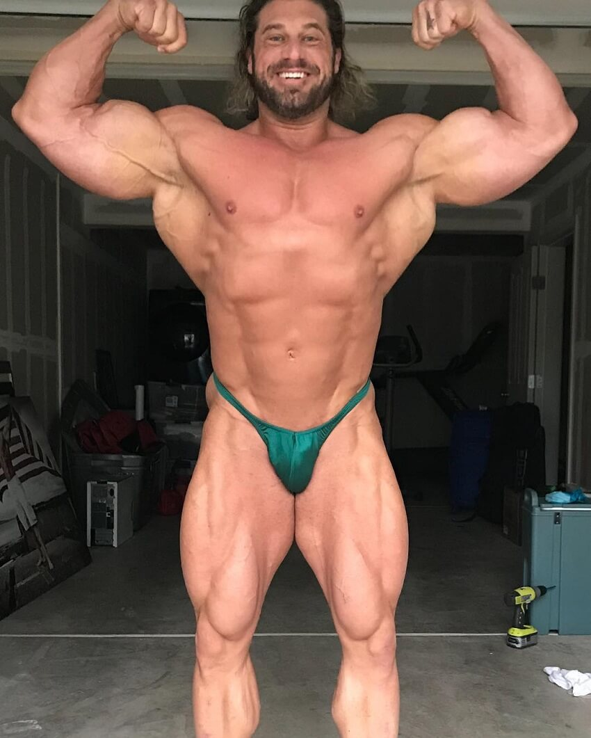 Gabe Moen doing a front double biceps pose shirtless
