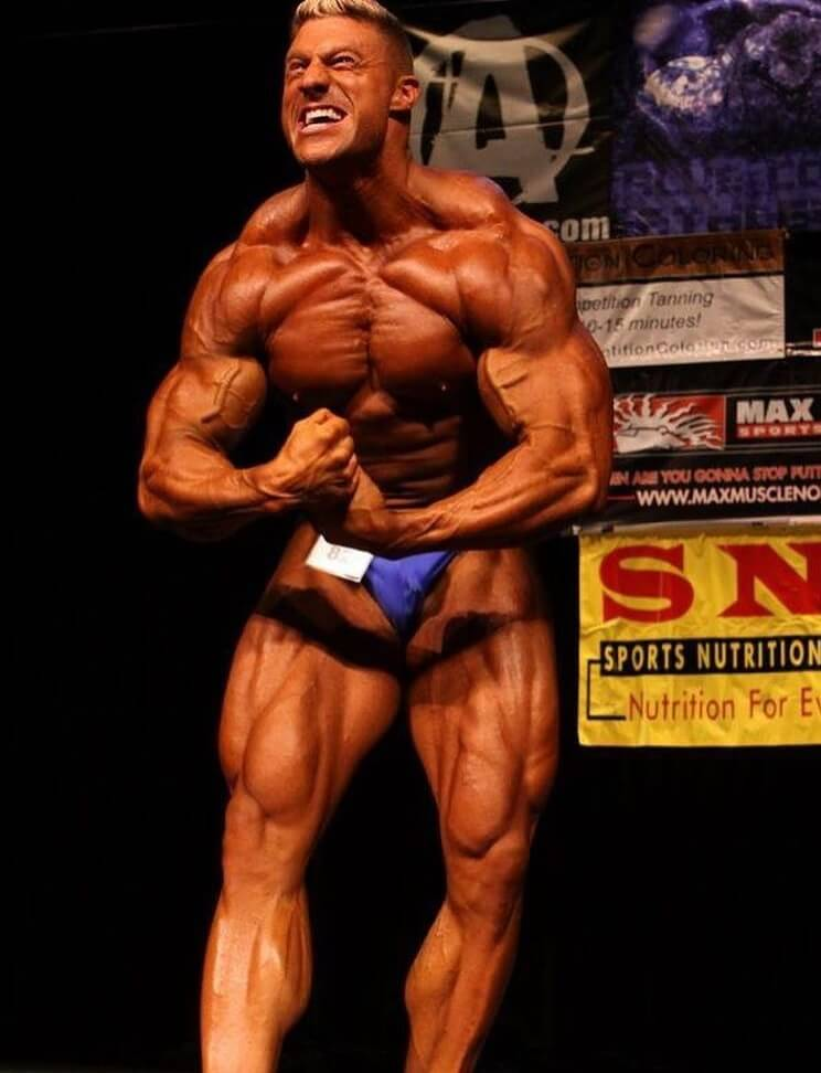Gabe Moen performing the most muscular pose on the bodybuilding stage