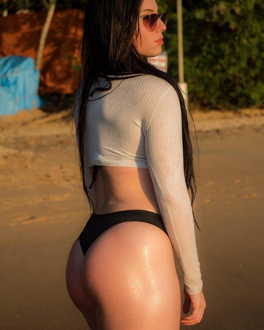 Gabriela Costa posing on the beach looking curvy