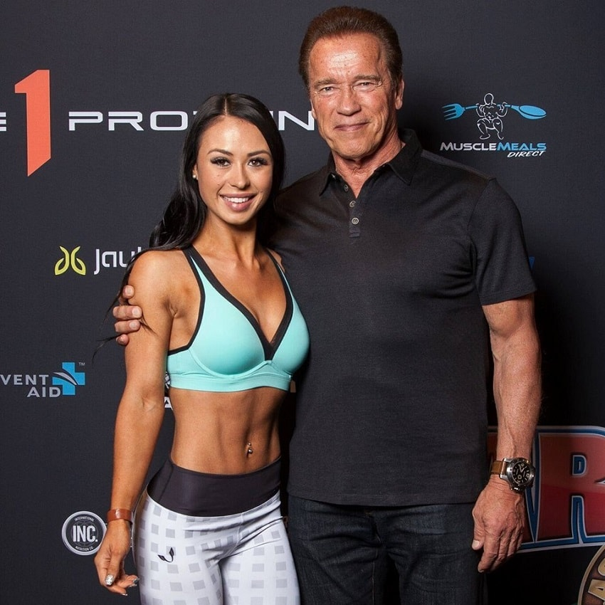 Katie Jean posing with the one and only Arnold Schwarzenegger