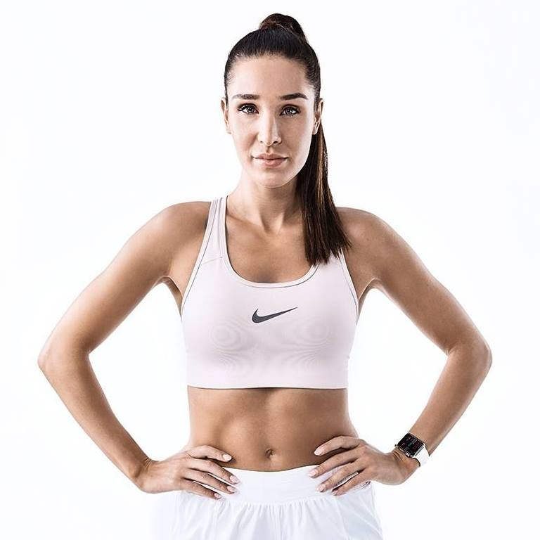 Kayla Itsines looking lean in a fitness photo shoot