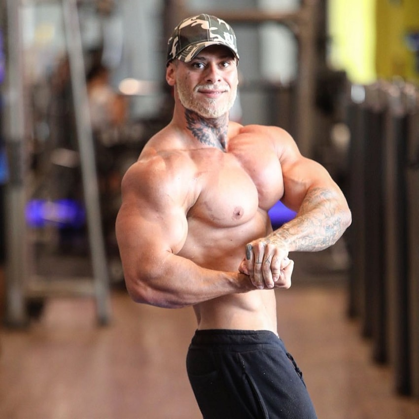 Leo Stronda doing a shirtless side chest pose