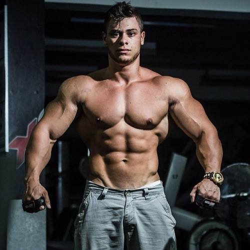 Leo Stronda posing shirtless for the photo looking lean and big
