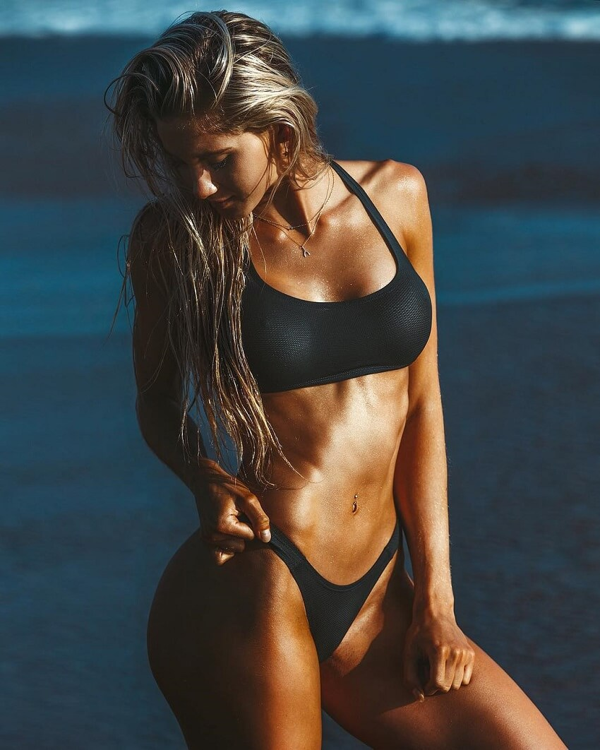 Lily Bowman posing in a black bikini, looking lean and toned