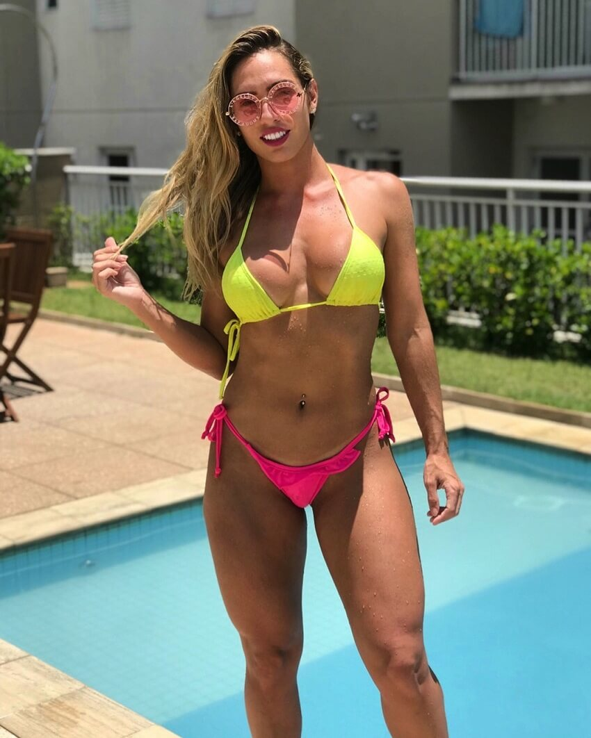 Marcela Gil posing in a bikini by the pool, looking fit and aesthetic