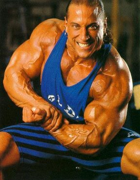 Mike Quinn flexing his big and ripped arms