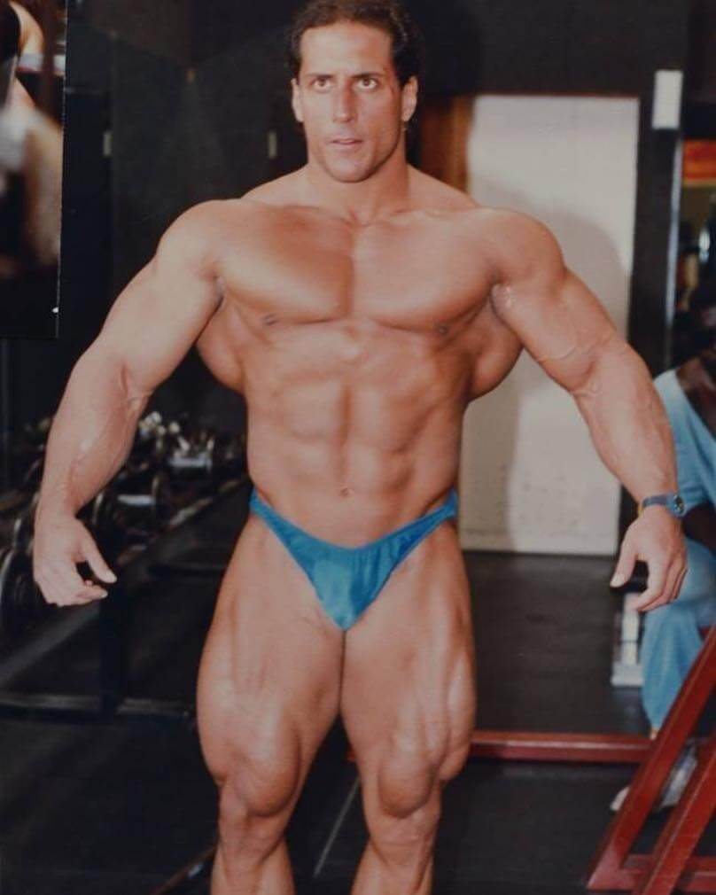 Mike Quinn posing shirtless looking huge and ripped