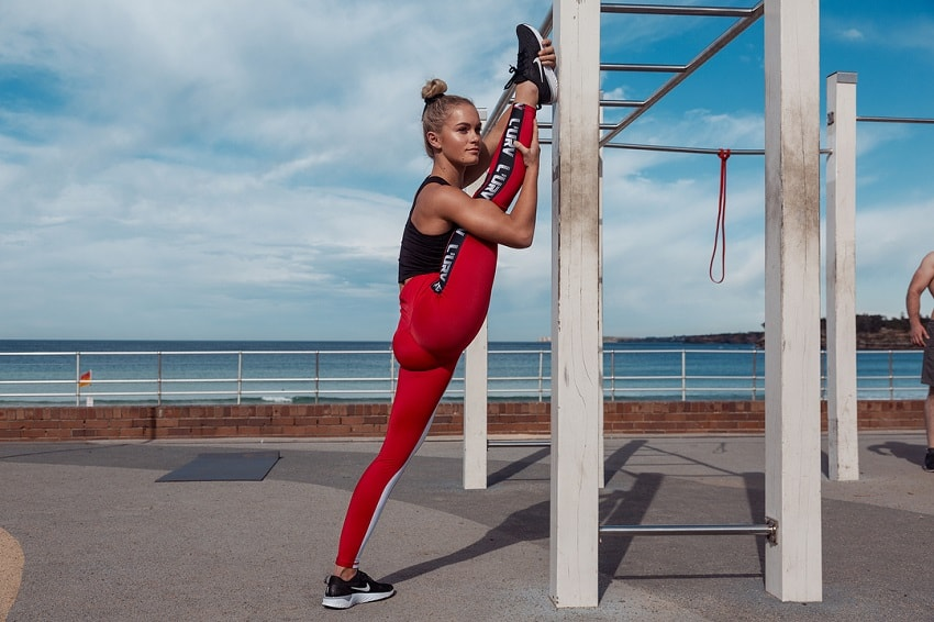 Morgan Rose Moroney stretching outdoors looking fit and lean