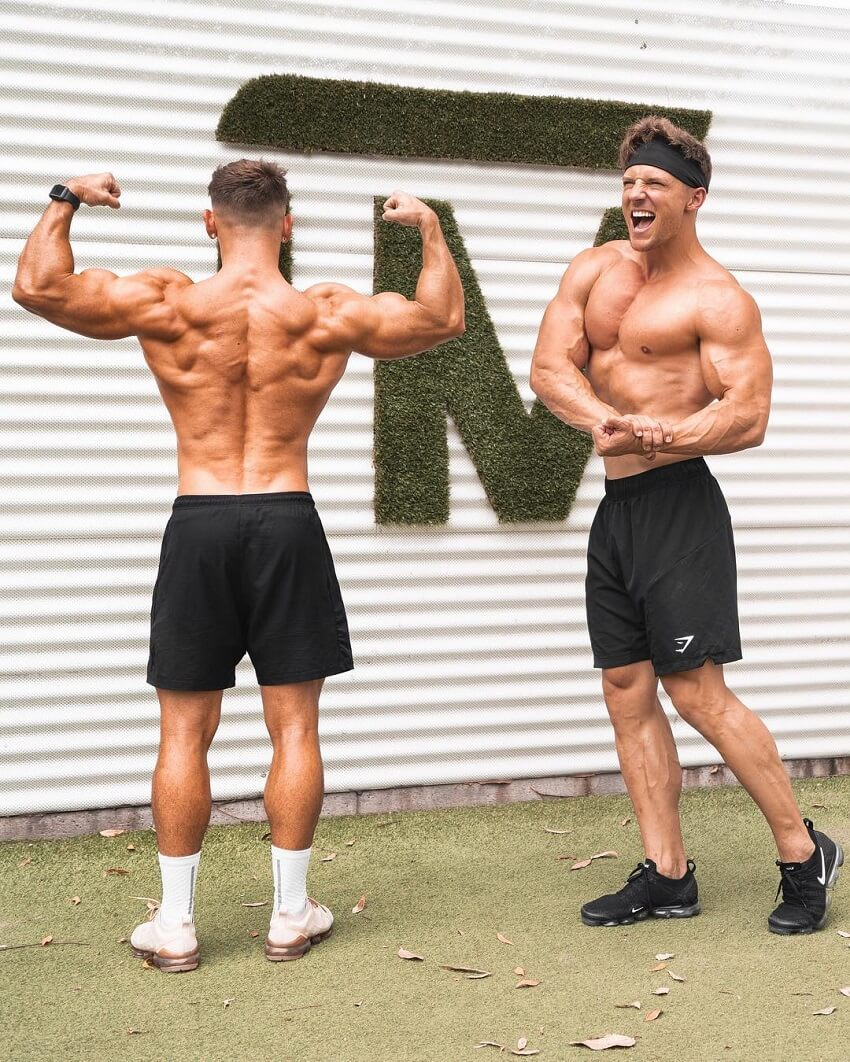Nathan McCallum flexing his muscles with Steve Cook