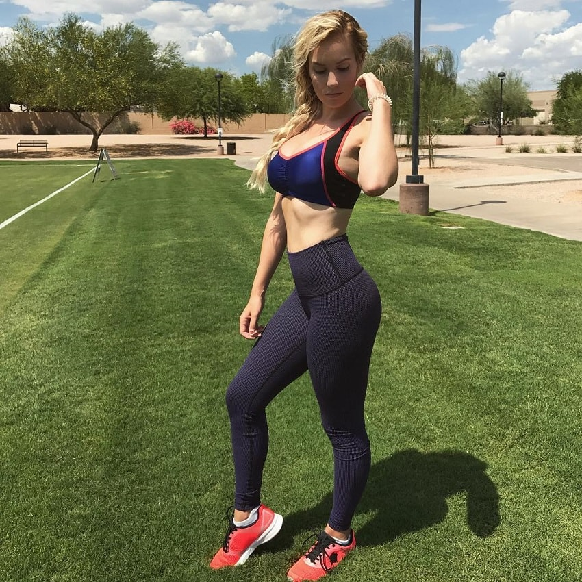 Paige Spiranac wearing sports clothes and posing for the photo