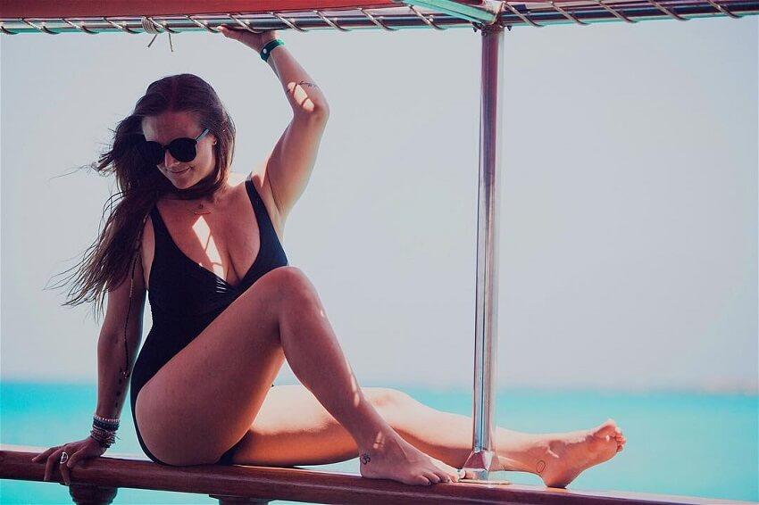 Rachel Brathen looking healthy and fit in her black swimming suit