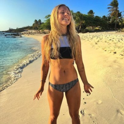 Rachel Brathen smiling on the beach, looking fit and healthy