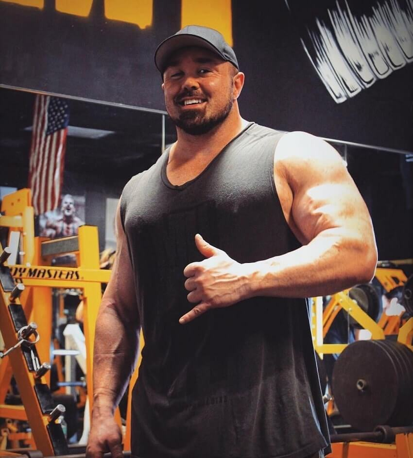 Ron Partlow posing for a picture, looking swole and huge