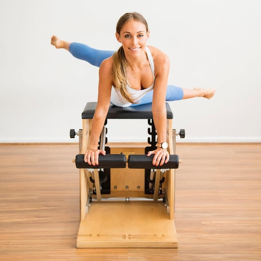 Sara Colquhoun doing Pilates while smiling for the photo