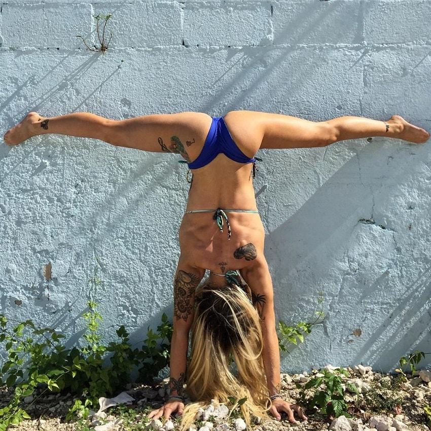 Skylar Stegner performing gymnastic stunts outdoors, looking fit