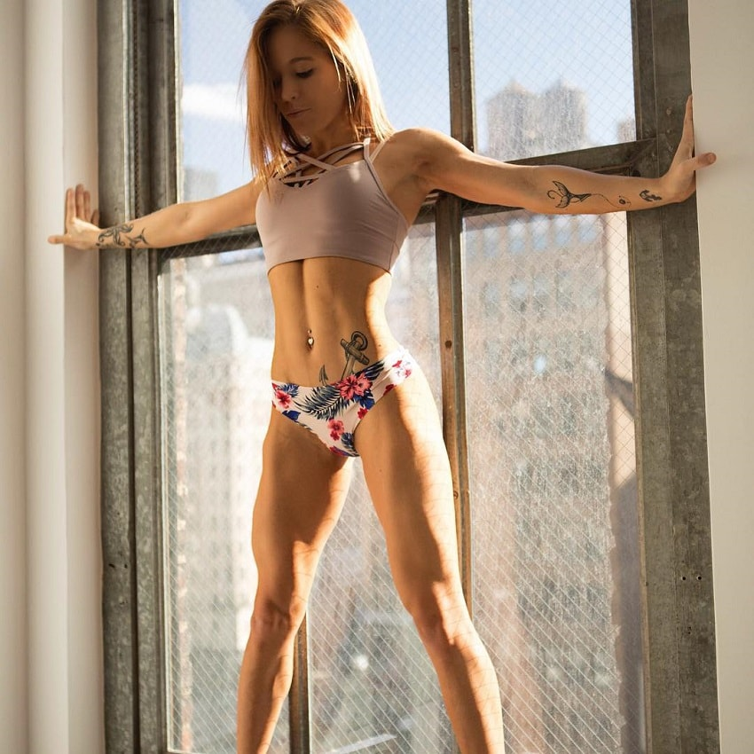 Skylar Stegner posing by the balcony window looking fit and aesthetic