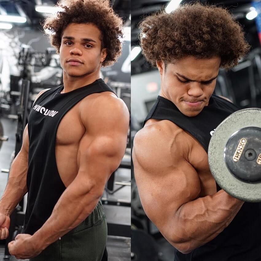 Uzoma Obilor training biceps and posing in the gym looking swole