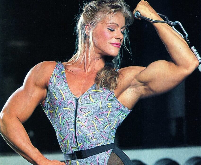 Anja Langer doing cable biceps curls