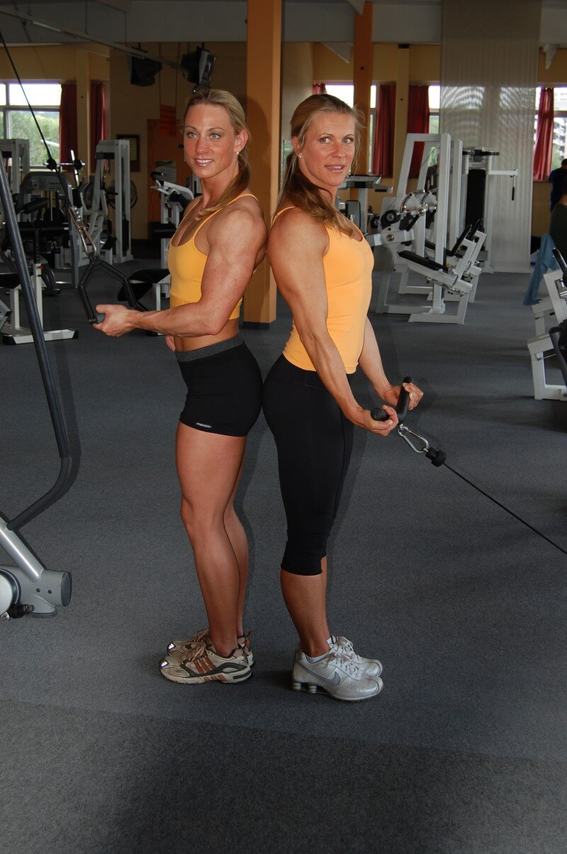 Anja Langer today, posing in the gym with a female training partner