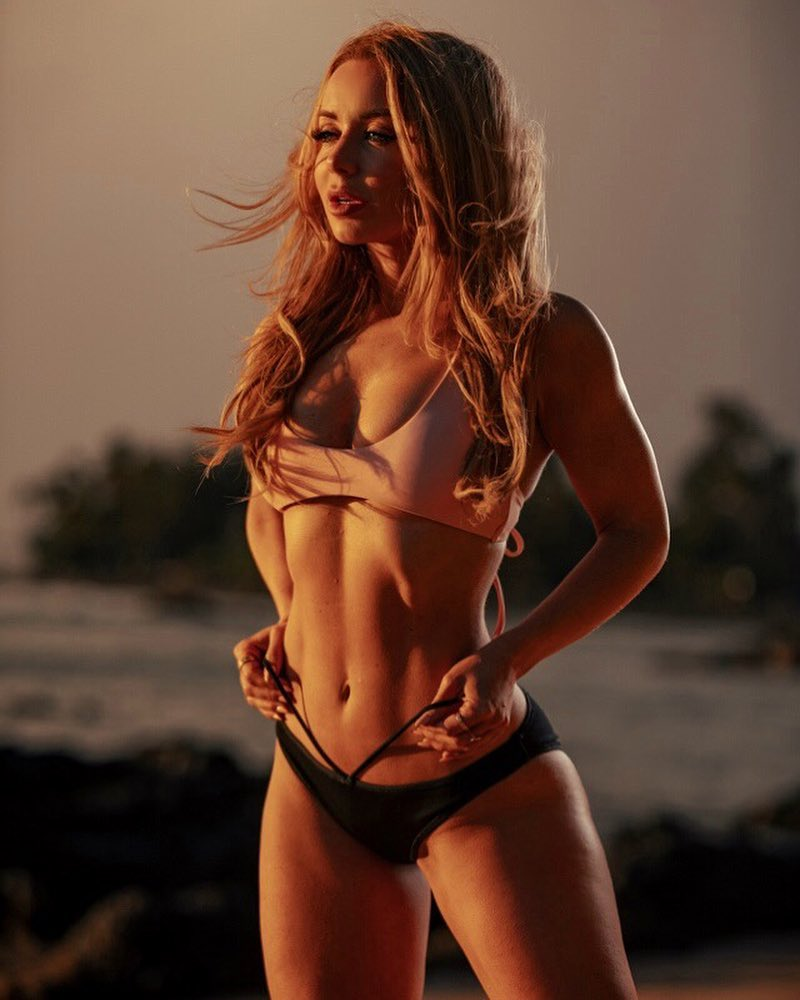 Annie Parker posing in a professional fitness photo shoot on the beach