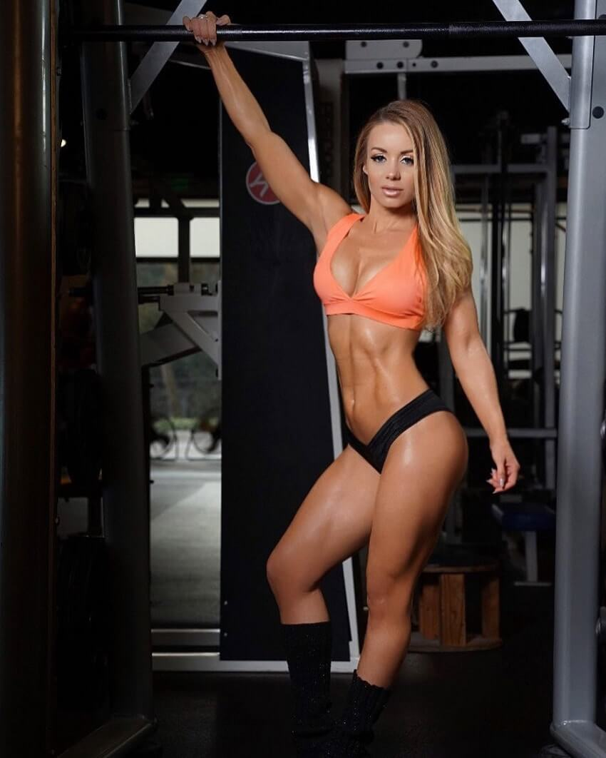 Annie Parker showing off her lean muscles in a fitness photo shoot in the gym