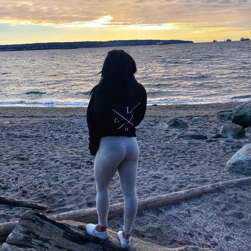 Azaria Glaim standing outdoors by the beah looking fit and curvy