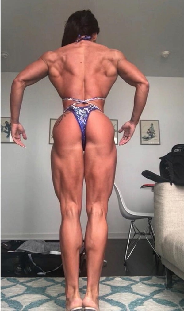 Azaria Glaim practicing posing in a bikini for a contest, looking muscular and aesthetic