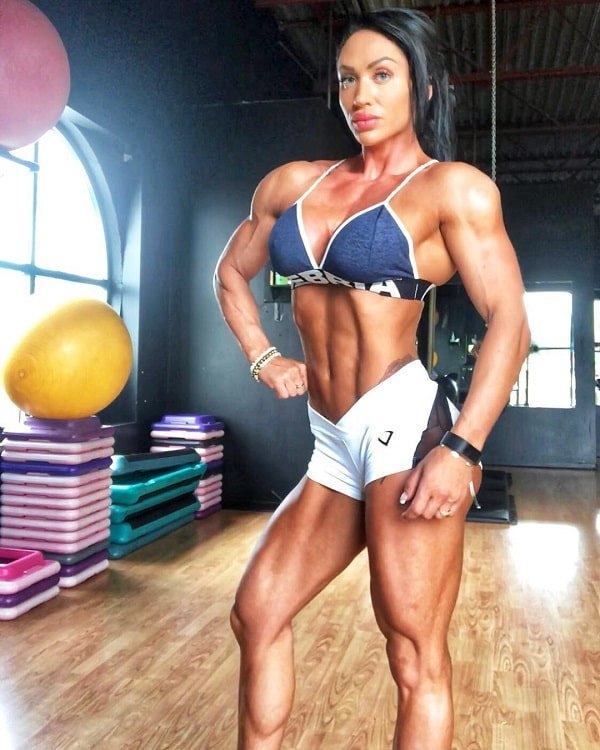 Azaria Glaim posing in in the gym, looking fit