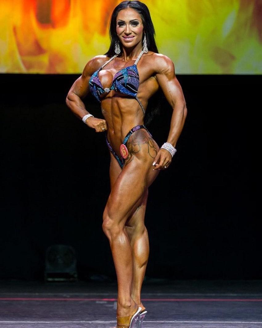 Azaria Glaim posing on the IFBB figure fitness stage