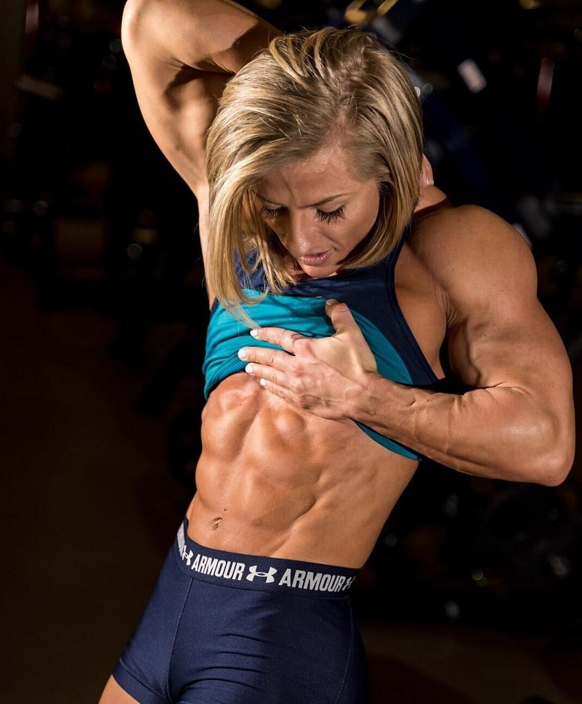 Brooke Walker flexing her abs in a fitness photo shoot