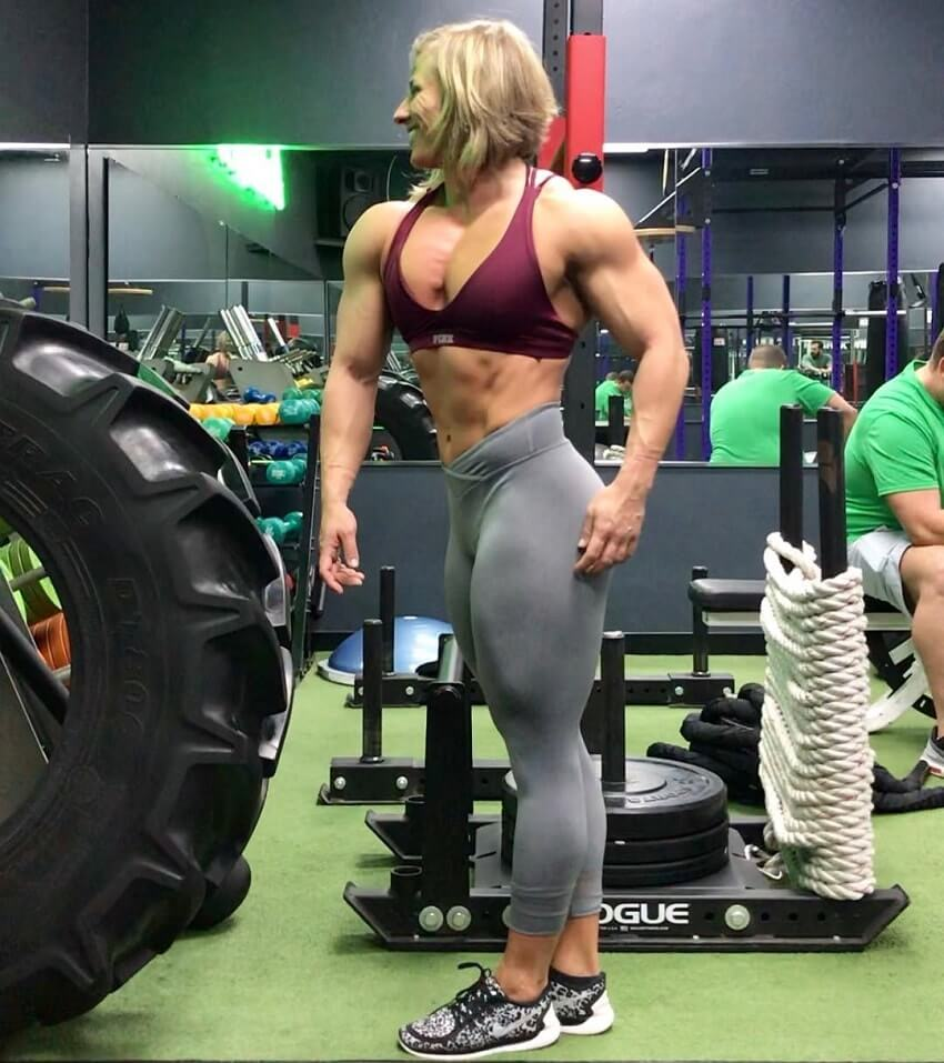 Brooke Walker performing a side pose in the gym