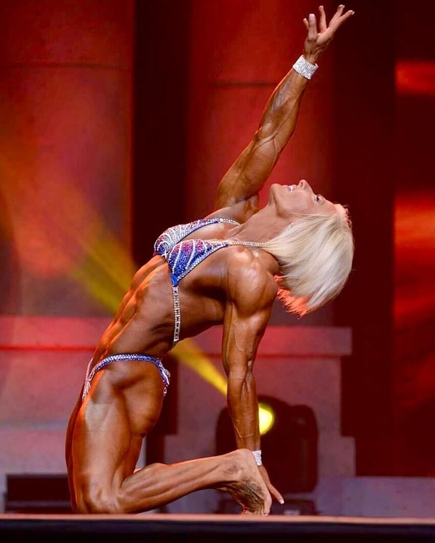 Brooke Walker posing on the Women's Physique stage