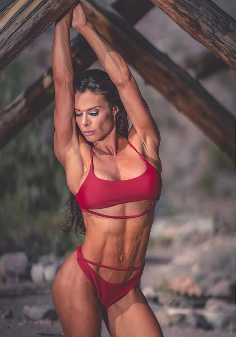 Camile Periat posing in a bikini looking ripped and fit