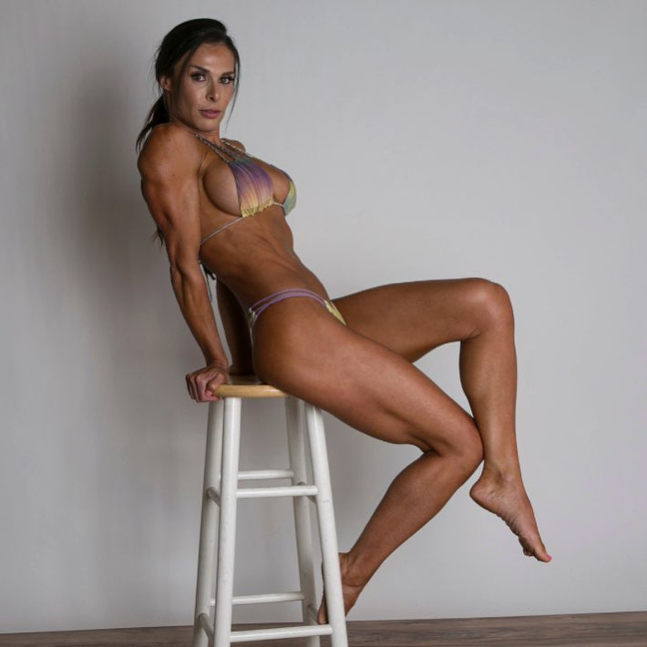 Camile Periat sitting on a chair posing in a bikini