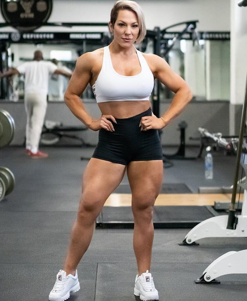 Carly Thornton posing in the gym looking fit and strong
