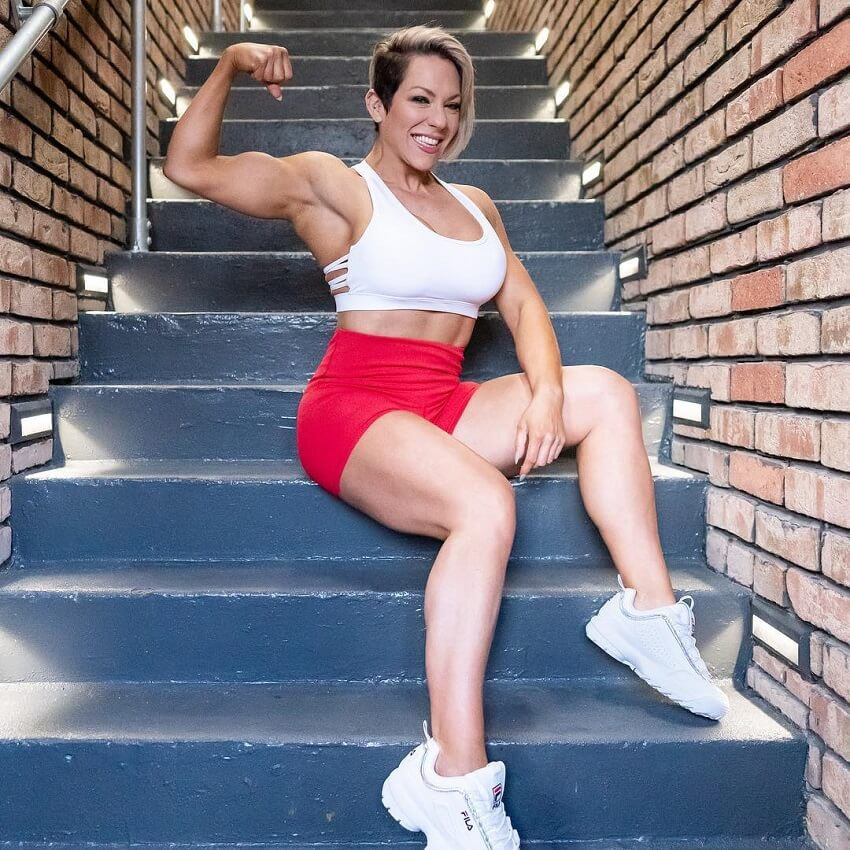 Carly Thornton flexing her biceps for the photo