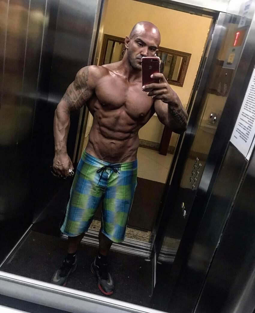 Danilo Franca taking a shirtless elevator selfie, looking muscular and ripped
